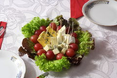 Blue cheese close up with grapes and salad on table Royalty Free Stock Photography
