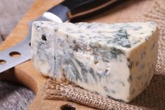 Blue cheese close-up on a kitchen wooden board Royalty Free Stock Image