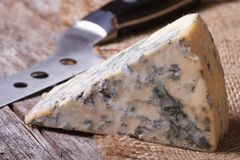 Blue cheese close up on an old wooden table Royalty Free Stock Photography