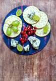 Blue cheese and crackers with fruits Royalty Free Stock Image