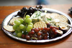 Blue cheese and crackers. With grapes Royalty Free Stock Photo