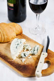 Blue cheese, croissant and wine Royalty Free Stock Images