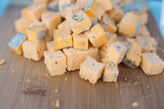 Blue cheese cut into dice Royalty Free Stock Images
