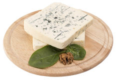 Blue cheese decorated. With leaves and walnut on wooden board Stock Photos