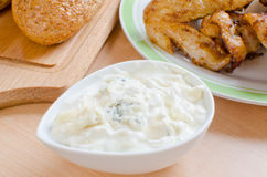 Blue cheese dip. Homemade blue cheese (gorgonzola) dip with deep fried chicken wings royalty free stock image