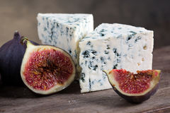 Blue cheese with fig. On a dark wooden background Stock Photography