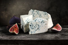 Blue cheese with fig. On a dark wooden background Royalty Free Stock Photo