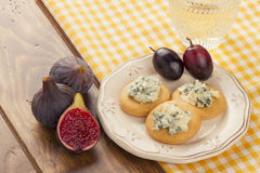 Blue cheese, figs, grapes and walnuts Stock Photography