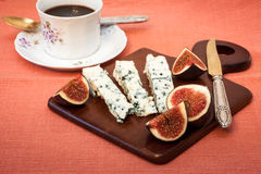 Blue cheese and fresh figs Stock Photos