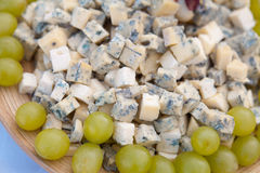 Blue cheese with fresh grapes Royalty Free Stock Image