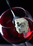 Blue cheese and glass of red wine . Stock Photography