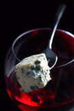 Blue cheese and glass of red wine . Stock Image