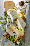 Blue cheese Gorgonzola with addition fresh pear, walnuts and honey Stock Images