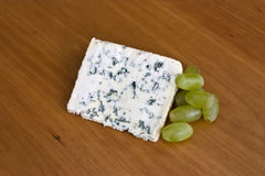 Blue cheese and grapes Royalty Free Stock Image