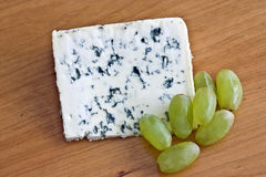 cheese and grapes Royalty Free Stock Images