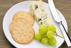 Blue cheese with grapes Royalty Free Stock Image