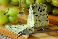 Blue cheese and grapes Stock Photography