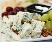 Blue cheese with grapes and nuts Stock Image