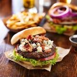 Blue cheese hamburger with crumbled bacon Royalty Free Stock Photos