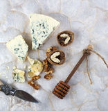 Blue cheese with honey and walnuts. Stock Photography