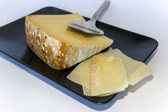 Blue cheese with knife Royalty Free Stock Image