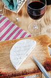 Blue cheese, knife and wine Stock Photos