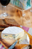 Blue cheese, knife and wine Royalty Free Stock Photo