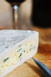 Blue cheese, knife and wine Royalty Free Stock Photos