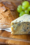 Blue cheese and loaf of bread Stock Photo