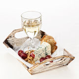 Blue cheese, nuts, grapes and wine Stock Photos