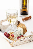 Blue cheese, nuts, grapes and wine Stock Photo