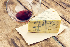 Blue cheese with overturned glass of wine Royalty Free Stock Image