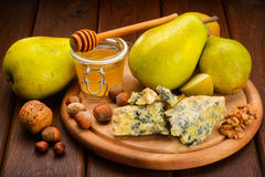 Blue cheese with pears Royalty Free Stock Photos
