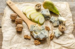 Blue cheese. With pears and walnuts stock photography