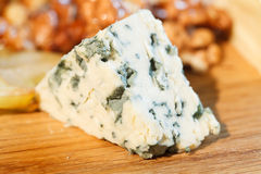 Blue cheese. A piece of blue cheese Royalty Free Stock Photo