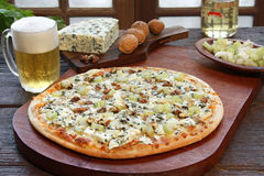 Blue cheese pizza. With a glass of beer and some ingredients Stock Photography