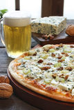 Blue cheese pizza. With a glass of beer and some ingredients Royalty Free Stock Photos