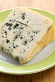 Blue cheese on plate Royalty Free Stock Photography