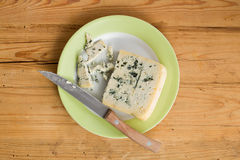 Blue cheese on plate Stock Photos
