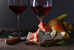 Blue cheese with prosciutto , pear and red wine Royalty Free Stock Images