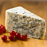 Blue cheese and red currant. Close up of blue cheese with red currant stock photo