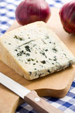 Blue cheese with red onion Royalty Free Stock Photography