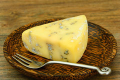 Blue Cheese Roquefort on Wooden Plate Stock Photos