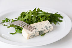 Blue cheese with rucola Royalty Free Stock Photography