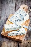 Blue cheese slices Royalty Free Stock Images