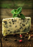 Blue cheese with spices and mint Royalty Free Stock Photo