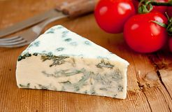 Blue cheese and tomatoes Royalty Free Stock Image