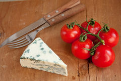 Blue cheese and tomatoes Royalty Free Stock Photo