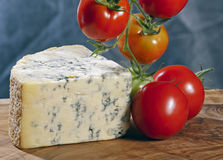 Blue cheese and tomatoes Royalty Free Stock Images
