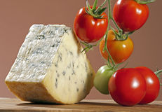 Blue cheese and tomatoes Stock Images